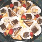 Photo of dessert platter including nanaimo bars, coconut squares, cakes and strawberries.