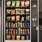 Vending machine filled with chocolate bars and chip bags.