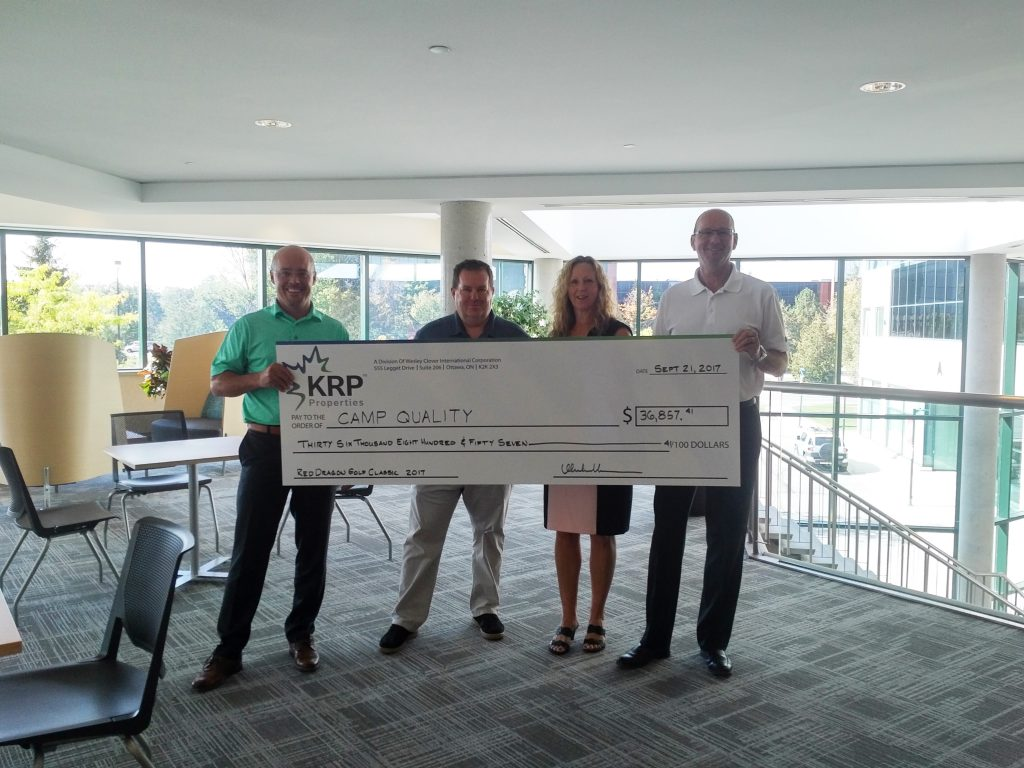 Award of jumbo cheque to Camp quality in the amount of $36,857.41 by Linda Sprung, Martin Vandewouw and Terry Young to Glenn Mooney