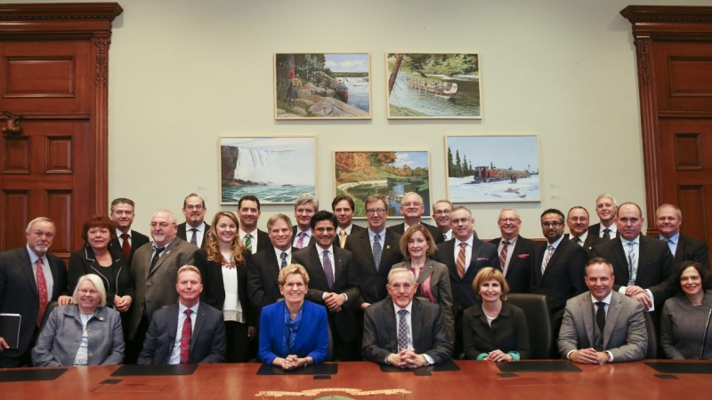 Group photo of political officials and influencers including Kathleen Wynn, Bob Chiarelli, Terry Matthews, Marianne Wilkinson, Jenna Sudds, Jan Harder, Jim Watson and many others.